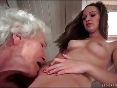 Grey haired granny rations out shaved young pussy