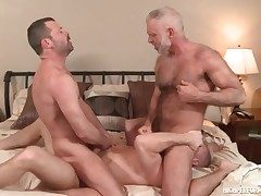 Three hot daddies in a gay anal threesome