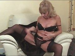 Mature blonde Cathy Oakley peels off to black lingerie